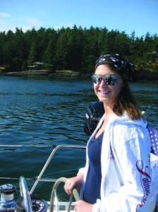 Tabitha at the helm in the Pacific Northwest