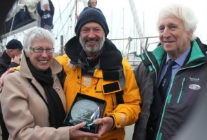 Ocean Cruising Club members Frances Rennie (left) and John Forsyth (right) present Jerry Hughes (centre) with an award of special recognition. Photo by Priscilla Travis.